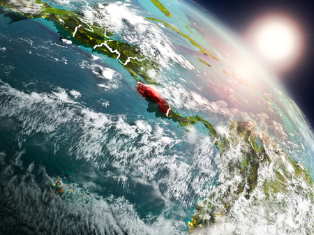 Sunset above Costa Rica from space on planet Earth with visible country borders. 3D illustration.