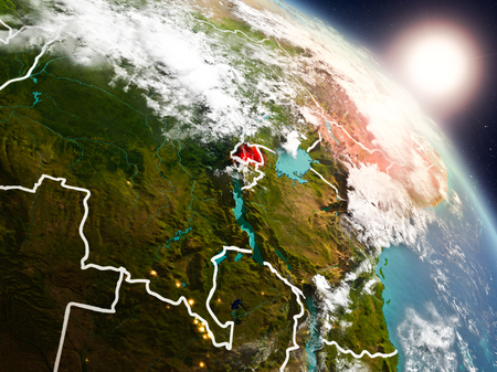 Sunset above Rwanda from space on planet Earth with visible country borders. 3D illustration.