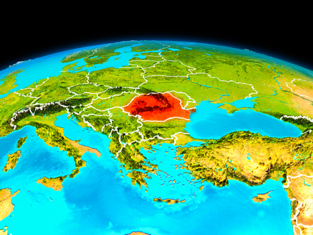Satellite view of Romania highlighted in red on planet Earth with borderlines. 3D illustration.