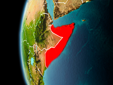 Evening over Somalia as seen from space on planet Earth with visible border lines and city lights. 3D illustration.