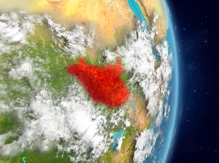Space view of South Sudan highlighted in red on planet Earth with atmosphere. 3D illustration.