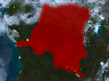 Country of Democratic Republic of Congo in red on planet Earth with clouds at night. 3D illustration. Stock Photo
