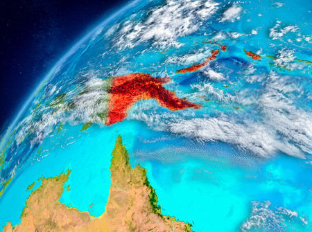 Country of Papua New Guinea in red on planet Earth with atmosphere. 3D illustration. Stock Photo