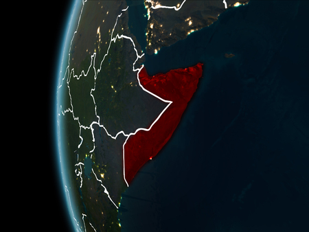Orbit view of Somalia highlighted in red with visible borderlines and city lights on planet Earth at night. 3D illustration.