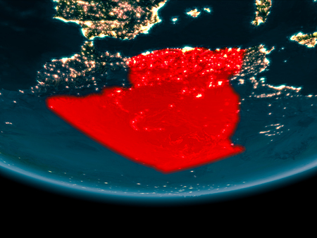 Algeria at night highlighted in red on planet Earth. 3D illustration.