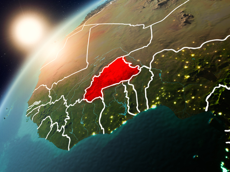 Burkina Faso during sunset highlighted in red on planet Earth with visible country borders. 3D illustration.