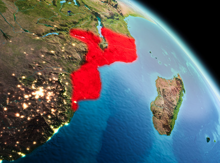 Satellite morning view of Mozambique highlighted in red on planet Earth. 3D illustration. Banco de Imagens