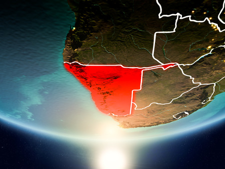 Namibia from orbit of planet Earth in sunrise with highly detailed surface textures and visible country borders. 3D illustration. Stock Photo