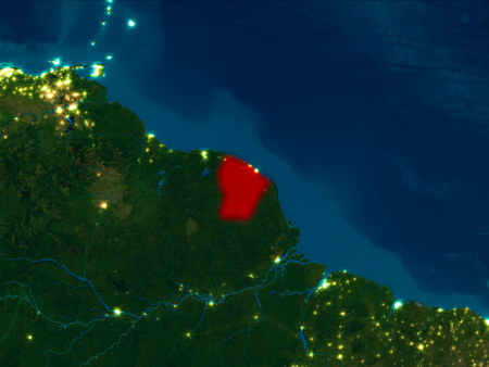 Satellite night view of French Guiana highlighted in red on planet Earth. 3D illustration.