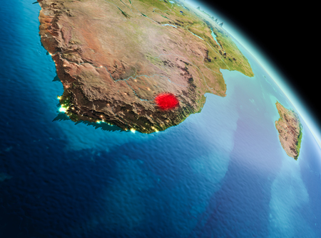 Satellite morning view of Lesotho highlighted in red on planet Earth. 3D illustration. 版權商用圖片