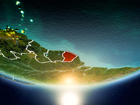 French Guiana from orbit of planet Earth in sunrise with highly detailed surface textures and visible country borders. 3D illustration. Stock Photo