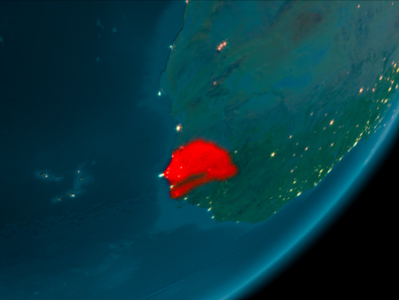 Night view of Senegal highlighted in red on planet Earth with atmosphere. 3D illustration.