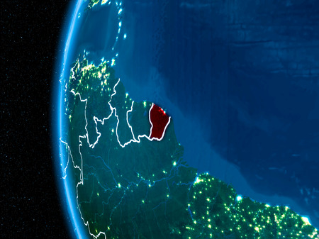 Space orbit view of French Guiana highlighted in red on planet Earth at night with visible country borders and city lights. 3D illustration. Stock Photo