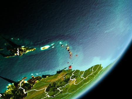 Caribbean in early morning light highlighted in red on planet Earth with visible border lines and city lights. 3D illustration. Stock Photo
