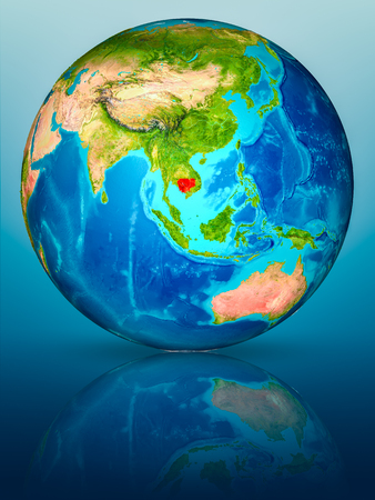 Cambodia in red on model of planet Earth on reflective blue surface. 3D illustration.