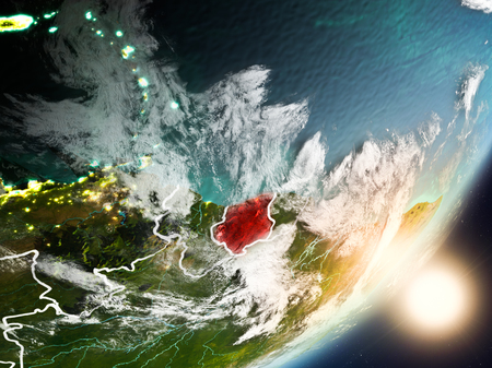Suriname from space with highly detailed surface textures and visible country borders. 3D illustration.