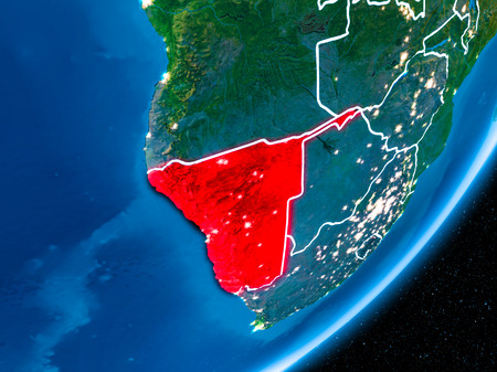 Namibia in red on planet Earth at night with visible borderlines and city lights. 3D illustration.