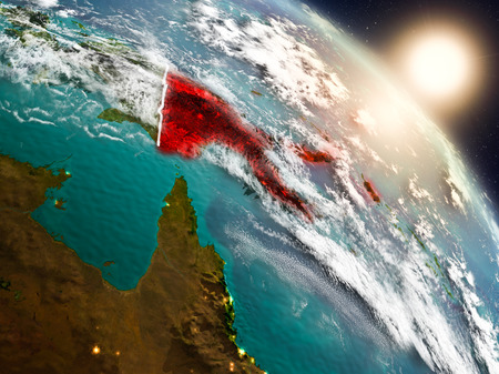 Sunset above Papua New Guinea from space on planet Earth with visible country borders. 3D illustration. Stock Photo