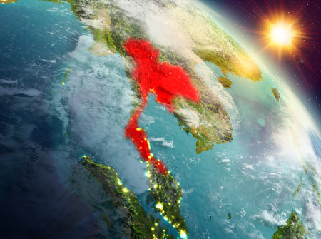 Sunrise above Thailand highlighted in red on model of planet Earth in space. 3D illustration.