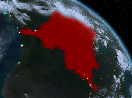 Night above Democratic Republic of Congo highlighted in red on model of planet Earth in space. 3D illustration.