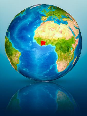 Ivory Coast in red on model of planet Earth on reflective blue surface. 3D illustration.