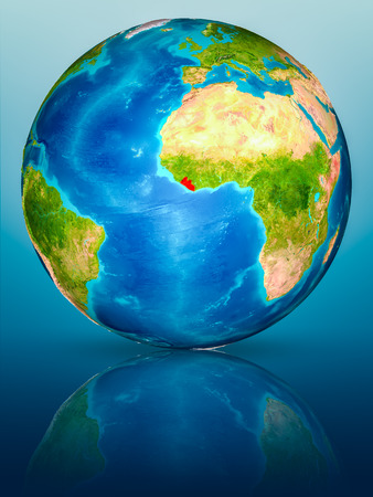 Liberia in red on model of planet Earth on reflective blue surface. 3D illustration.