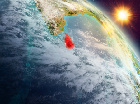 Sunrise above Sri Lanka highlighted in red on model of planet Earth in space. 3D illustration.