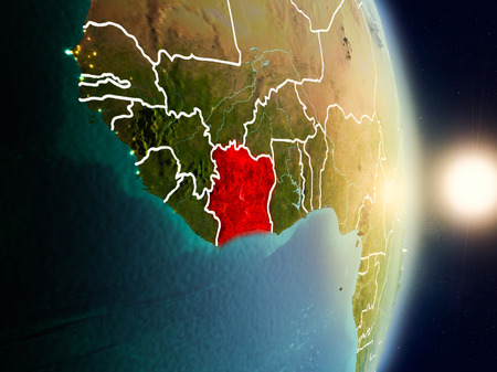 Ivory Coast during sunrise highlighted in red on planet Earth with visible country borders. 3D illustration.