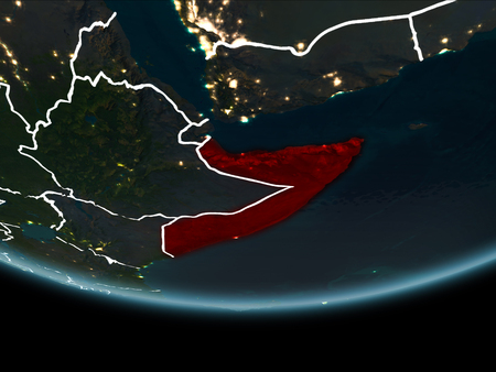 Somalia highlighted in red on planet Earth at night with visible borders and city lights. 3D illustration.