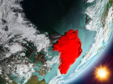 Greenland from orbit of planet Earth in sunrise with highly detailed surface textures and clouds. 3D illustration.