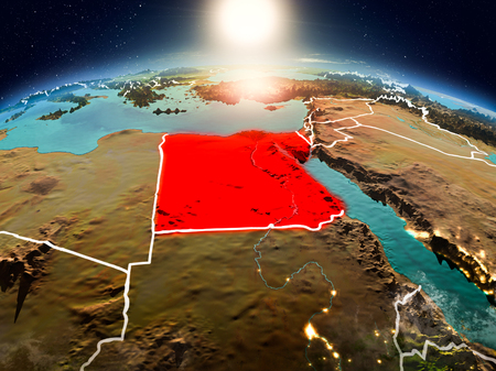 Sunrise above Egypt highlighted in red on model of planet Earth in space with visible country borders. 3D illustration. Stock Photo