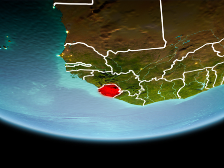 Country of Sierra Leone in red on planet Earth in the evening with visible border lines and city lights. 3D illustration. Stock Photo