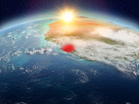 Satellite view of Sierra Leone highlighted in red on planet Earth with clouds during sunrise. 3D illustration.