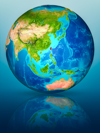 Taiwan in red on model of planet Earth on reflective blue surface. 3D illustration.