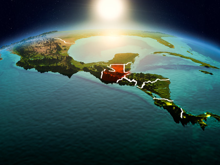 Sunrise above Guatemala highlighted in red on model of planet Earth in space with visible country borders. 3D illustration.
