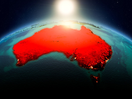 Sunrise above Australia highlighted in red on model of planet Earth in space with visible country borders. 3D illustration.