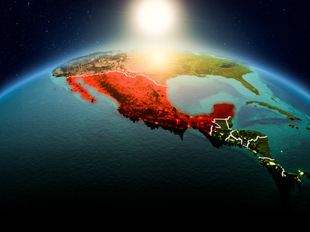 Sunrise above Mexico highlighted in red on model of planet Earth in space with visible country borders. 3D illustration. Фото со стока