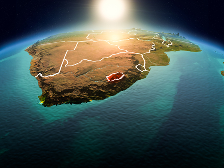 Sunrise above Lesotho highlighted in red on model of planet Earth in space with visible country borders. 3D illustration.