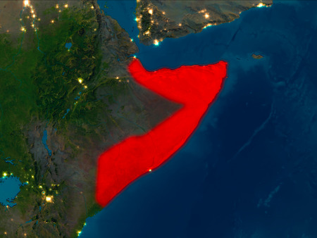 Satellite night view of Somalia highlighted in red on planet Earth. 3D illustration.