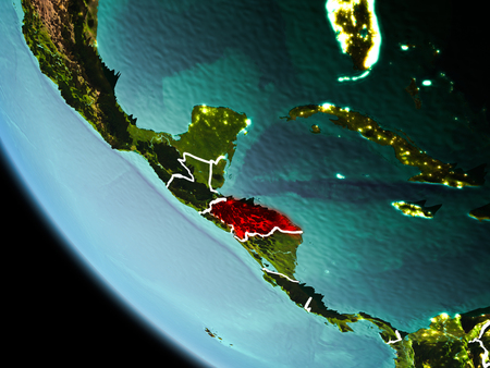 Honduras from orbit of planet Earth at night with highly detailed surface textures with visible border lines and city lights. 3D illustration.