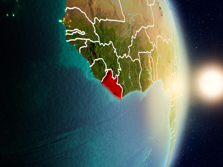 Liberia during sunrise highlighted in red on planet Earth with visible country borders. 3D illustration.