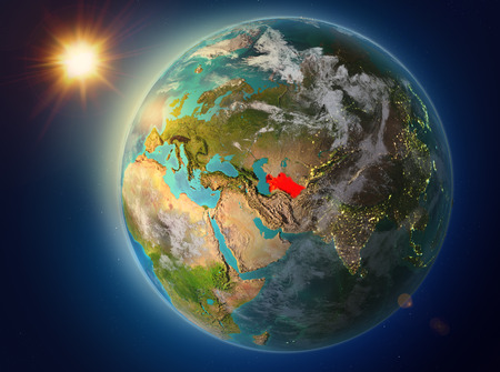 Sunset above Turkmenistan highlighted in red on planet Earth with atmosphere and clouds. 3D illustration.