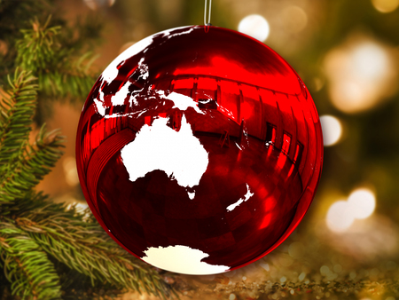Australia on shiny Christmas ball in shape of planet Earth hanging from Christmas tree. 3D illustration.