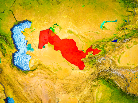 Uzbekistan on model of 3D Earth with blue oceans and divided countries. 3D illustration.