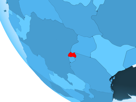 Rwanda highlighted in red on blue political globe with transparent oceans. 3D illustration.