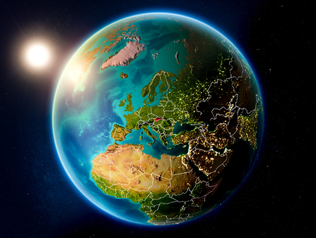 Sunset above Slovakia highlighted in red on planet Earth with visible country borders. 3D illustration.