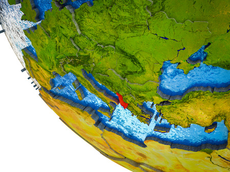 Albania on model of Earth with country borders and blue oceans with waves. 3D illustration.