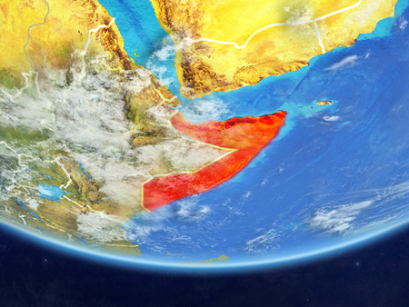 Somalia on realistic model of planet Earth with country borders and very detailed planet surface and clouds. 3D illustration.
