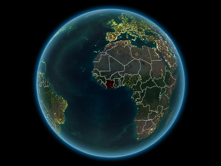 Ivory Coast in red with visible country borders and city lights from space at night. 3D illustration. Banque d'images - 111086378