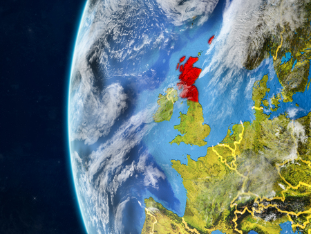 Scotland from space on model of planet Earth with country borders and very detailed planet surface and clouds. 3D illustration.